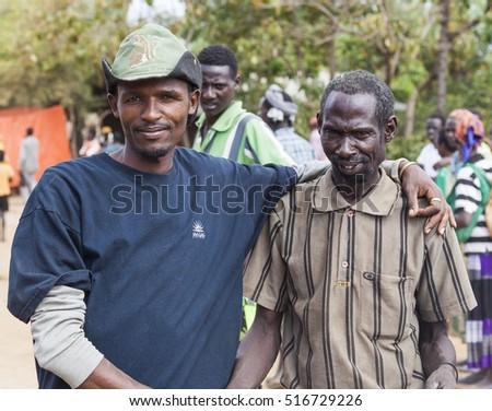 BONATA VILLAGE, OMO VALLEY. ETHIOPIA - JANUARY 2, 2014: Unidentified people at local village market. #516729226