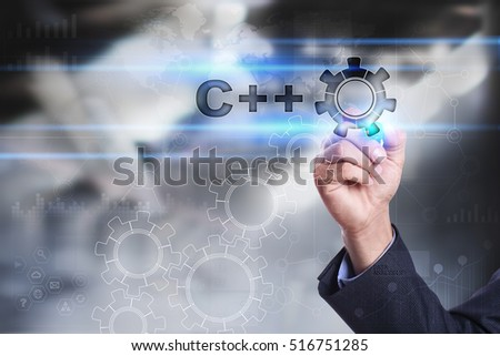 Businessman is drawing on virtual screen. c++ concept #516751285