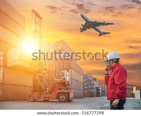 engineer control forklift handling the container box in imports exports logistics zone #516777298