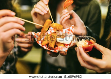 Portrait of group of friends visiting eat market in the street. #516896983