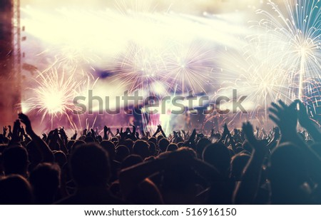 New Year concept - fireworks and cheering crowd celebrating the New year #516916150