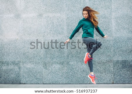 Fitness sport girl in fashion sportswear doing yoga fitness exercise in the street, outdoor sports, urban style Royalty-Free Stock Photo #516937237