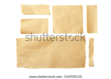 brown ripped pieces of paper on white background #516940150
