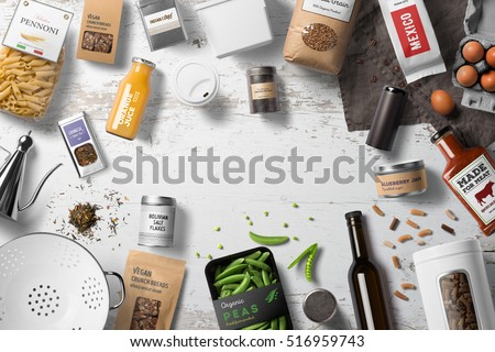 Food packaging set, bottles, cans, jars, pachages, bags on a white table,  top view with copy space Royalty-Free Stock Photo #516959743