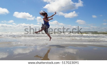 Dancing girl on the beach #517023091