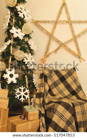 photo zone in vintage style Christmas gifts wrapped in craft paper and lie near the New Year tree #517047853