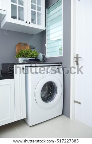 washing machine in a kitchen room #517227385