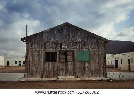 Old wooden house for fishermen with three windows #517268902