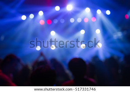 Effects blur Concert, disco dj party. People with hands up having fun #517331746