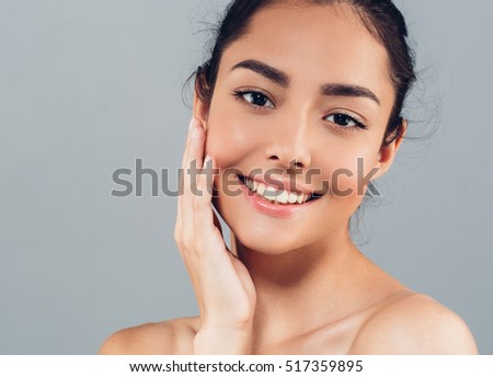 Woman face beauty portrait with healthy skin teeth smile daily makeup, brunette beautiful young model isolated on gray #517359895