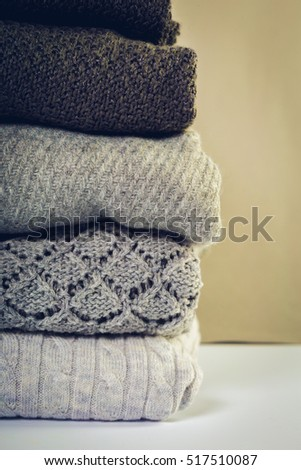 Stack of cozy knitted sweaters #517510087