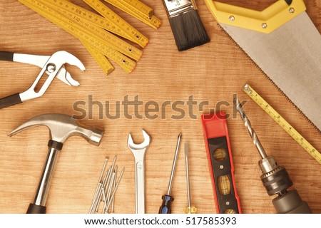 Assorted work tools on wood #517585393