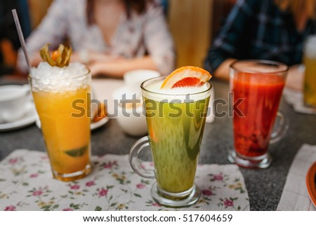 Closeup of three creative sweet exotic alcoholic party cocktails in restaurant at bar background #517604659