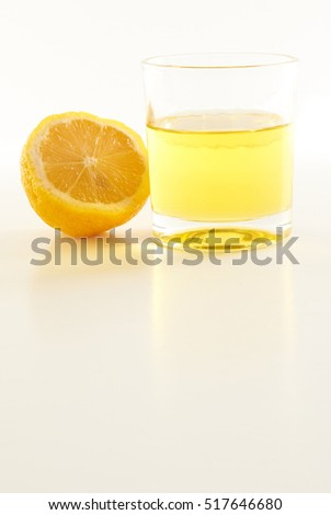 yellow lemon and a glass of lemonade on a white background #517646680