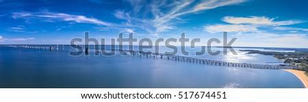 Panorama of the Chesapeake Bay Bridge near Annapolis, Maryland.  #517674451