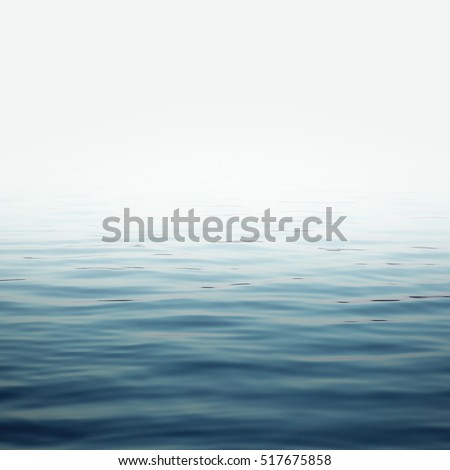 sea with waves and clear sky calm ocean water surface with small ripples Royalty-Free Stock Photo #517675858