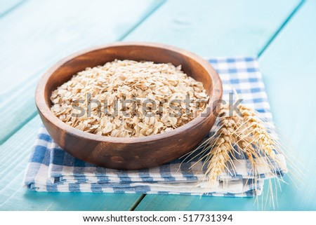 Oat flakes in a bowl on a table, selective focus, copy space #517731394