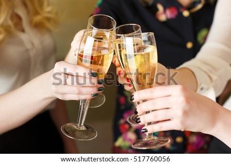 Hands holding the glasses of champagne making a toast #517760056