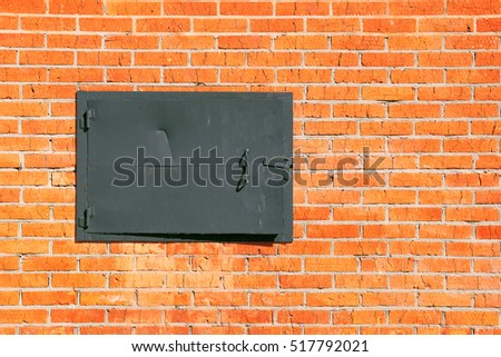 A fragment of a brick wall with a metal hatch closeup. Texture, background #517792021