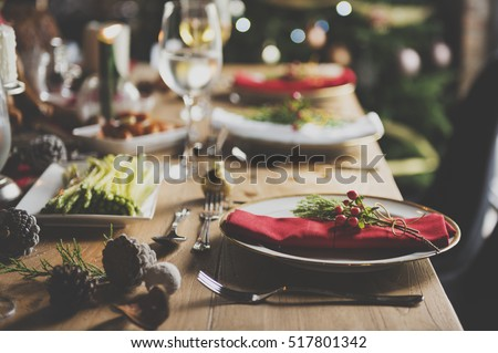 Christmas Family Dinner Table Concept Royalty-Free Stock Photo #517801342