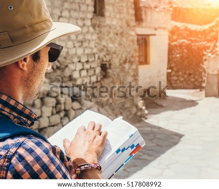 Close up image tourist with guide book on asian street #517808992
