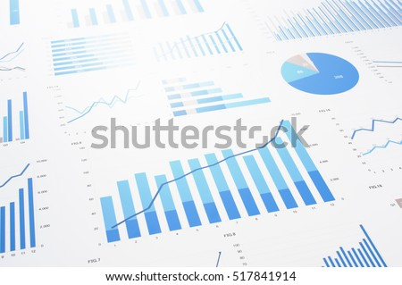 Many charts and graphs. Reflection light and flare. Concept image of data gathering and statistical working.  Royalty-Free Stock Photo #517841914
