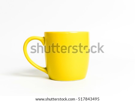 Yellow tea cup isolated on white. #517843495