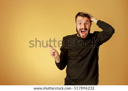 Portrait of young man with shocked facial expression Royalty-Free Stock Photo #517896232