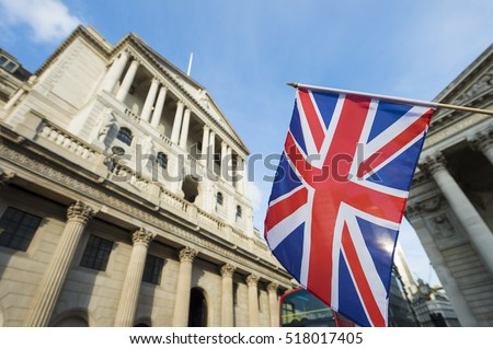 British Union Jack flag flying in front of the Bank of England in the City of London financial center #518017405
