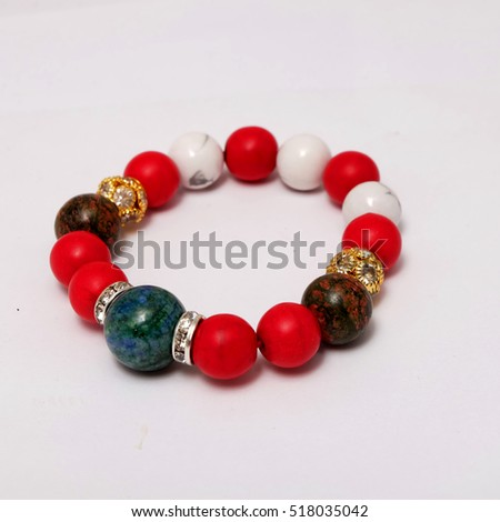 jade quartz stone red glass bracelet isolated on white background  and crystal accessories #518035042
