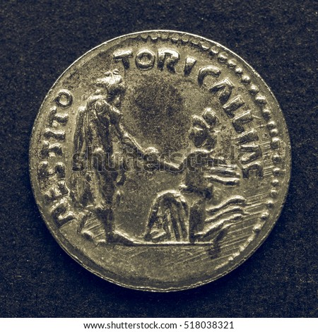 Vintage looking Ancient Roman coins on a black background #518038321