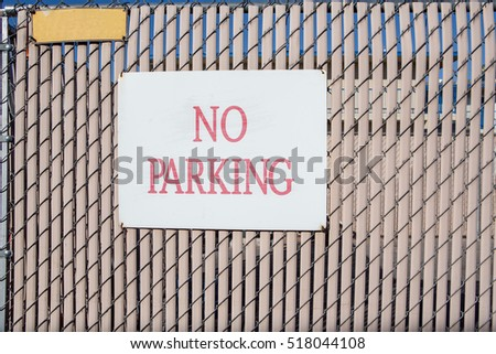no parking sign on modern vertical plastic and wire wall