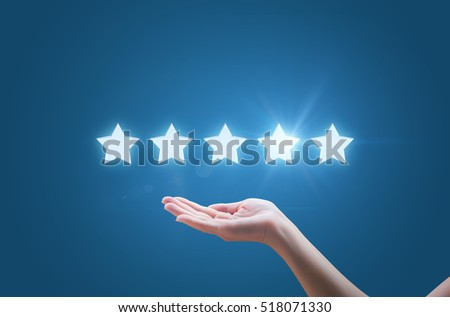 Businesswoman hand holding five stars isolated on blue background #518071330