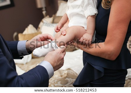 God Parents dressing God Child Baby for Christening Baptism #518212453