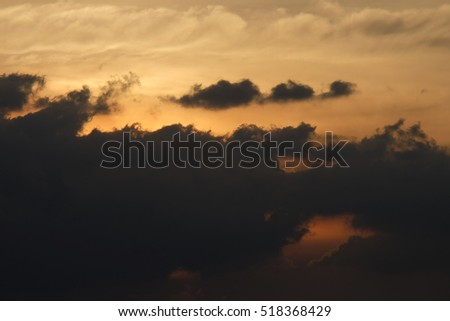 Sunset in the city, Amazing sunset over building on the town, Strom cloud sky over city , Cloudscape  #518368429