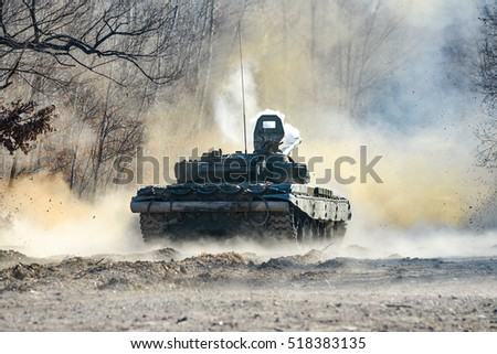 Russian tank shot on a forest road #518383135