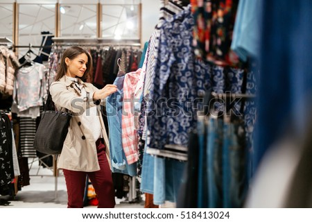 Beautiful woman shopping trendy clothes #518413024