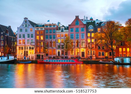 Amsterdam city view with Amstel river at sunset #518527753