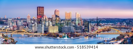 """Pittsburgh, Pennsylvania skyline at dusk. Located at the confluence of the Allegheny, Monongahela and Ohio rivers, Pittsburgh is also known as """"City of Bridges"""""""