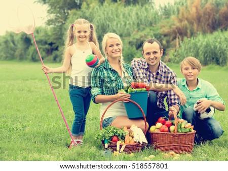 Joyful family of four spending summer day at countryside  #518557801