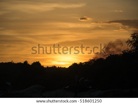 Sunset sky with silhouette of the trees #518601250