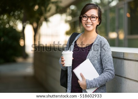 Pretty female student portrait mixed race bright cheerful positive confident young scholar #518602933
