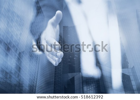 Business man offer a deal or help, handshake, double exposure #518612392