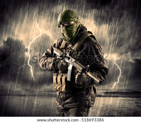 Portrait of a dangerous armed terrorist with mask and gun in a thunderstorm with lightning #518693386