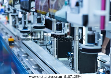 Robotic machine vision system in phone factory Royalty-Free Stock Photo #518713594