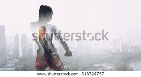 She is fighting for success . Mixed media Royalty-Free Stock Photo #518724757