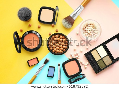 Set of decorative cosmetics on color background Royalty-Free Stock Photo #518732392