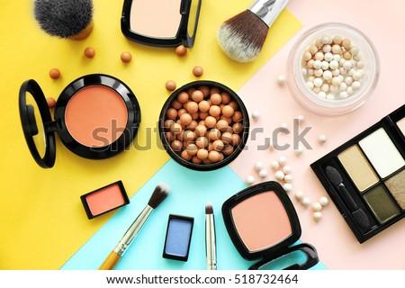 Set of decorative cosmetics on color background Royalty-Free Stock Photo #518732464