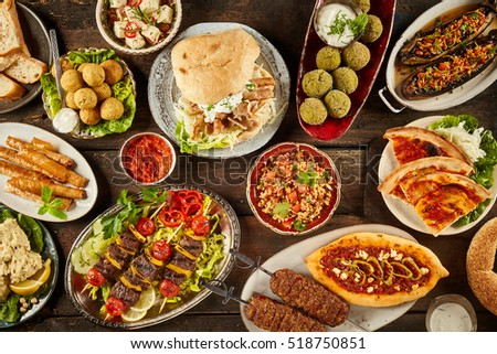 Top down view on freshly prepared delicious varieties of Mediterranean dishes on wooden table #518750851
