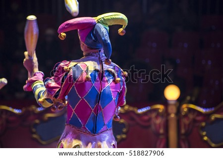 Jugglers in the circus and audience blurred Royalty-Free Stock Photo #518827906